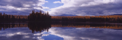 Reflection of Clouds and Trees in Water, Little Bitterroot Lake, Montana, USA Photographic Print by  Panoramic Images