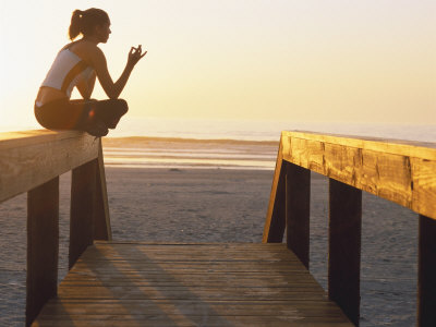 Woman Doing Yoga at Beach During Sunrise Photographic Print by Kevin Radford