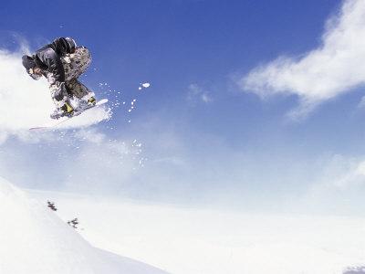 Man on Snowboard Jumping Photographic Print by Kurt Olesek