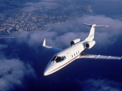Lear Jet in Flight Photographic Print by Garry Adams