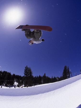 Airborne Snowboarder in Half Pipe Position Photographic Print by Kurt Olesek