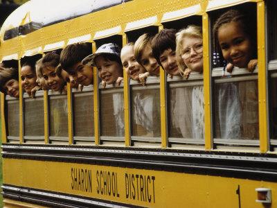 School Children Looking Out School Bus Windows Photographic Print by Len Rubenstein