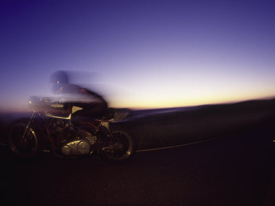 Blurred Motion of Man on Motorcycle Photographic Print by David Wasserman