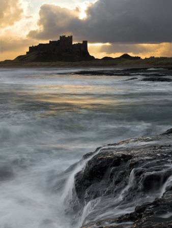 View of Bamburgh Castle at Sunset, UK Photographic Print