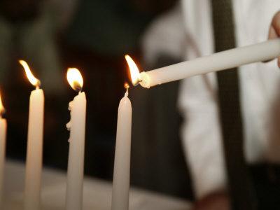 Boy Lighting Candles at Bar Mitzvah Photographic Print by Bill Keefrey