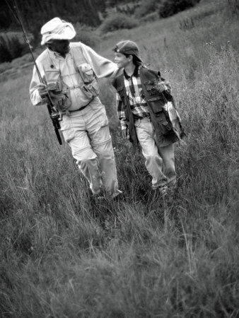 Grandfather and Boy in Field with Fishing Poles, CO Photographic Print by Bob Winsett
