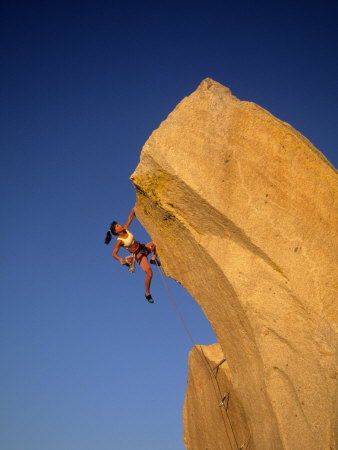 Woman Climbing Cliff Wall Photographic Print by Greg Epperson