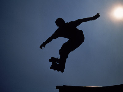 Rollerblader in Mid-Air Photographic Print by Jeff Greenberg
