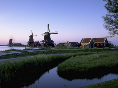 Windmills at Sunset, Zaanstad, North Holland Photographic Print by Walter Bibikow