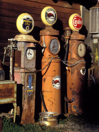 Three Old Gas Pumps Photographic Print