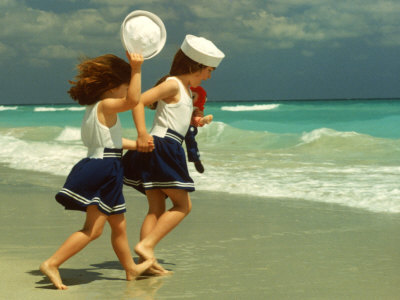 Two Girls in Sailor Suits Running on Beach Photographic Print by Christine Lowe