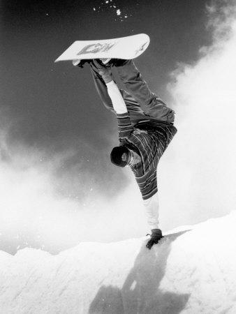 Snowboarder Doing a Handstand Photographic Print by Kurt Olesek