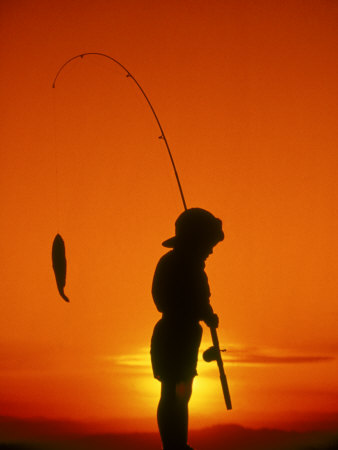 Silhouette of Boy Fishing at Sunset Photographic Print by Dean Berry