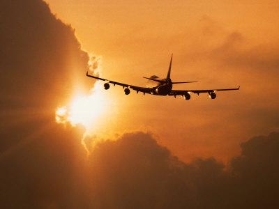 Jumbo Jet Banking Into Sunset Photographic Print by Peter Walton