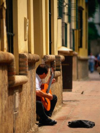 Guitarist Along Callejon Del Agua, Seville, Spain Photographic Print by Kindra Clineff