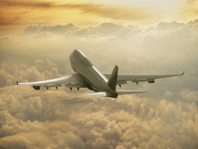 Jumbo Jet Above Clouds at 35000 Feet Photographic Print by Peter ...