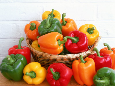 Sweet Peppers in and Around Basket Photographic Print by David Ball