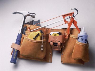Tool Belt with Hammer, Tape Measure, Caulk Gun Photographic Print by Dan Gair