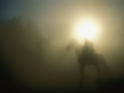 A Person on a Horse is Silhouetted in the Fog Photographic Print by Sisse Brimberg