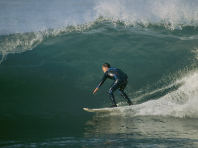 A Surfer Rides a Wave Photographic Print by Roy Toft
