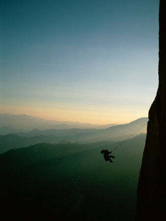 A Rock Climber from the 90 Degree Face of a Mountain Wall Photographic Print by Barry Tessman