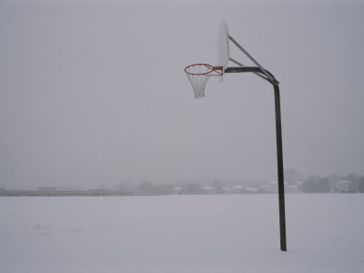Basketball Goal Standing by Itself in the Middle of a Blizzard Photographic Print by Brian Gordon Green