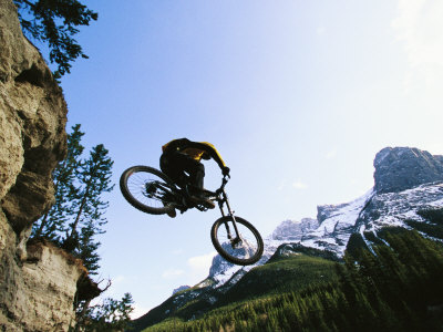Man Jumping on His Mountain Bike with Ha Ling Peak in the Background Photographic Print by Mark Cosslett