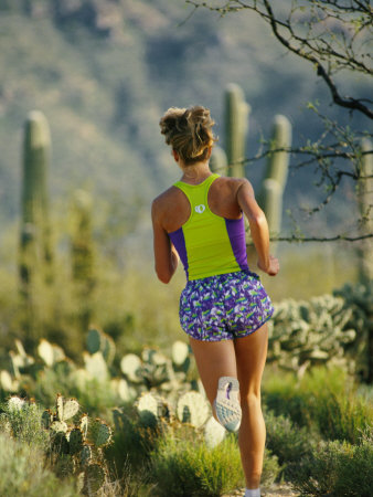 A Woman Runs Through the Desert Landscape Photographic Print by Dugald Bremner!