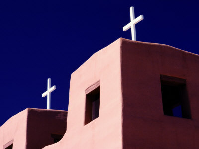 View of the Shadowed Walls of an Adobe Church in Chimayo Photographic Print by Todd Gipstein