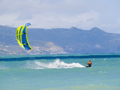 Man Kiteboarding in Turquoise Water Ocean off Maui Island Photographic Print by Mark Cosslett