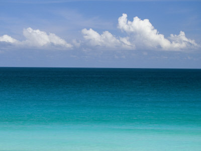Clear Blue Water and White Puffy Clouds Along the Beach at Cancun Photographic Print by Michael Melford