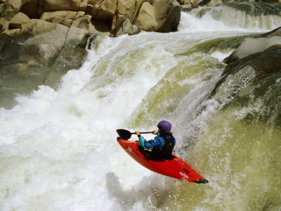 A Kayaker Careens over a Triple Drop Waterfall into the Swirling White Water Below Photographic Print by Barry Tessman