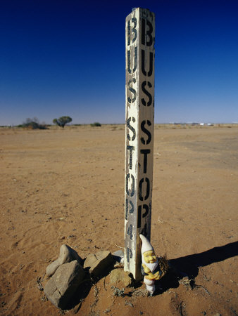 A Garden Gnome at a Bus Stop in an Outback Desert Town Photographic Print