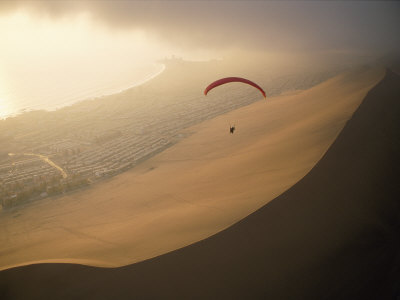 Ocean Gusts Keep a Paraglider Aloft Above Cerro Dragon, a Desert Dune Photographic Print by Joel Sartore