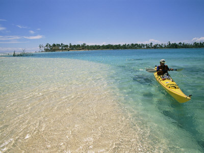 A Person Goes Kayaking in the Sea Photographic Print by Kate Thompson