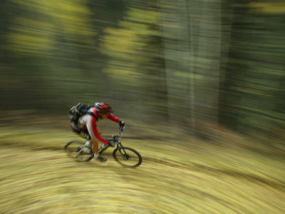 Jim Hall Speeds down Bear Creek Trail on a Bicycle Photographic Print by Bill Hatcher