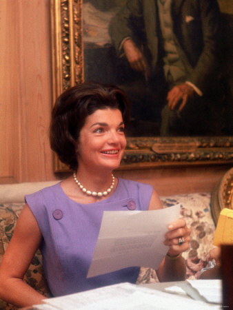 First Lady Jacqueline Kennedy Looking over Some Papers at the White House Photographic Print by Ed Clark