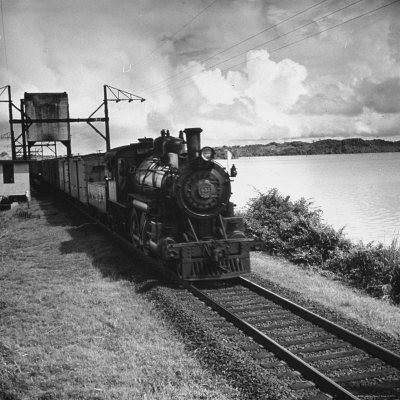 Railroad Train Following Tracks Beside Panama Canal Photographic Print by Thomas D. Mcavoy