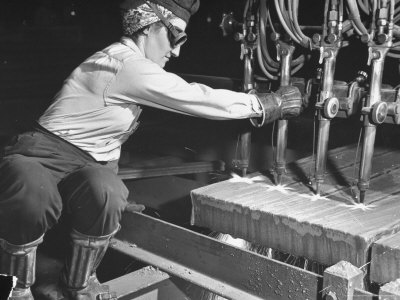 Female Steel Worker Operating Four Torch Machine to Cut Large Slab of Steel at Mill Photographic Print