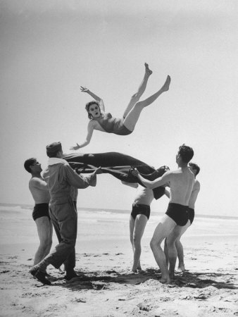 Army Men Bouncing Starlet Majorie Woodworth Into the Air Photographic Print by John Florea