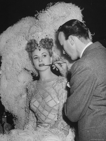 """Chorus Girl Getting Makeup Applied During Production of the Movie """"The Ziegfeld Follies"""" Photographic Print by John Florea"""