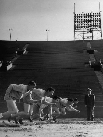Coach Jess Hill, Leading the Track Team's Practice Photographic Print by John Florea