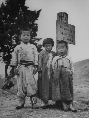 Children Standing in Front of Boundary Zone Sign Written in Russian, English, and Korean Photographic Print by John Florea