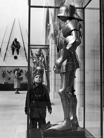 Little Boy Staring Up at Medieval Suit of Armor in the Metropolitan Museum