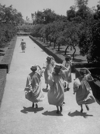 Late For Graduation, Five Seniors Holding on to Their Caps and Race to the Ceremony Photographic Print by Ed Clark