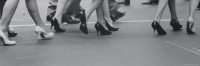 Women Walking on the Street in Spike Heeled Shoes Photographic Print by James Burke