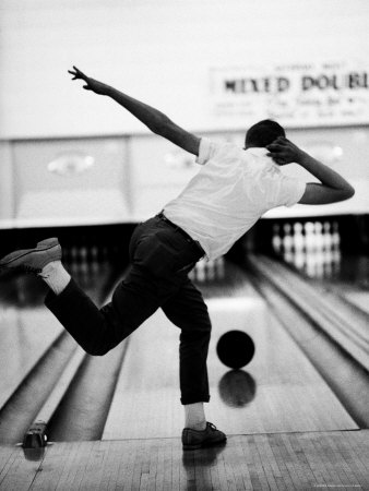 Boy Bowling at a Local Bowling Alley Premium Photographic Print by Art Rickerby