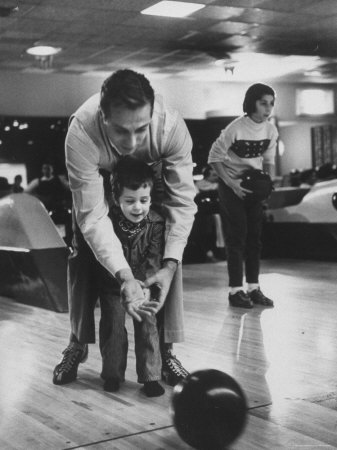 Dad Showing 3 Year Old Daughter the Basics of Bowling Premium Photographic Print