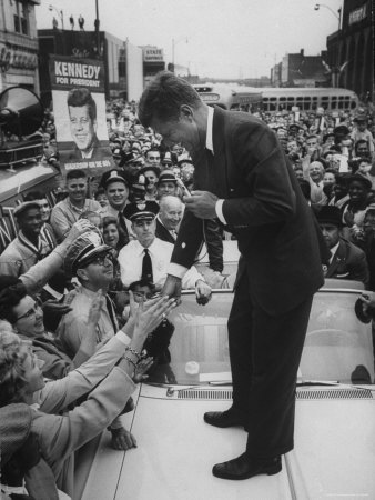 Senator John F. Kennedy Speaking on the Hood of a Car During a Campaign Tour Photographic Print by Ed Clark