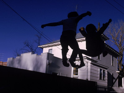 Silhouette of Children Bouncing on a Trampoline Photographic Print by Bill Eppridge